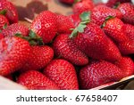 Picture of  a group of strawberries in a market stall - stock photo