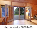Log cabin living room in the evening light - stock photo