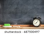 Chalks And Blackboard With Alarm Clock, Education And Time Management Concept - stock photo