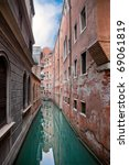 Venice channel with buildings - stock photo