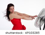 woman in a red evening gown and a fan - stock photo