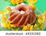 traditional ring cake with icing sugar on easter table - stock photo