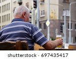 BRATISLAVA, SLOVAKIA - August 12, 2017: An old man in retirement age holding his mug with beer - stock photo