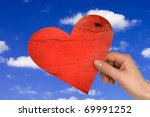 love concept. hand with heart on sky background - stock photo