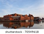 The historic building of the Baltic Philharmonic Orchestra with a ship in the background. Gdansk, Poland. - stock photo