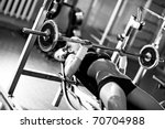 Young woman weight training. Black and white colors. - stock photo