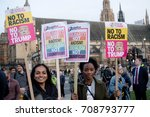 London, United Kingdon - Febuary 20th, 2017: Protesters gather in Parliament Square to protest the invitation to United States President Donald Trump on a state visit to Great Britain.  - stock photo