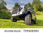 GRANTOWN ON SPEY, SCOTLAND - September 3 2017: Land Rover Defender parked on steep hill - stock photo