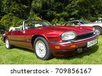 BRODIE, SCOTLAND - August 13 2017: Classic Jaguar XJS parked on grass - stock photo