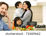 Mother, Father  And Children Prepare A meal,mealtime Together - stock photo