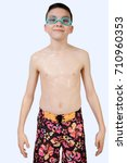 Young teenage caucasian boy wearing swimwear - stock photo