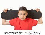 Young teenage caucasian boy with his skateboard - stock photo