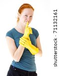 redhead young woman with yellow gloves as a housewife - stock photo