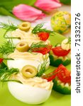 eggs with  mayonnaise and olives as appetizer for easter - stock photo