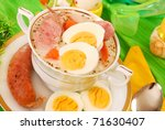 traditional polish white borscht with eggs and sausage in white dishware   for easter - stock photo