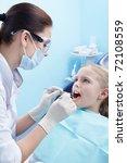Children's doctor treats your child's teeth - stock photo