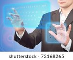 Hands pushing a button on a touch screen. - stock photo