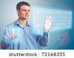 Men pushing a button on a touch screen. Two Virtual Keyboard. - stock photo