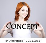 "Red-haired businesswoman show abstract word ""concept''. - stock photo"
