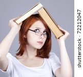 Red-haired businesswoman  keep books in hand. - stock photo