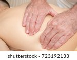 Teenage boy laying on a massage table, having a back massage - stock photo