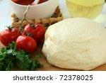 dough, tomato sauce, olive oil and tomato pizza ingredients - stock photo