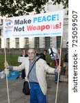 London, 28th September 2017:- Protesters gather in Whitehall, opposite Downing Street, to protest the growing tensions between North Korea and the USA - stock photo