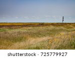 Railroad Track on Canadian Prairie in Late Summer Under Blue Sky - stock photo