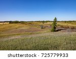 Railroad Track and Trees on Canadian Prairie Under Blue Sky - stock photo