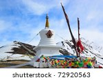 White Tibetan pagoda near the snow mountain in Sichuan province, China - stock photo