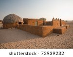 A traditional thatched roof mud hut and home in the Thar desert in Khuri, Rajasthan, India - stock photo