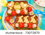 funny easter breakfast with bunny and chicken shape on sandwich for child - stock photo