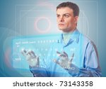 Representative young Men pushing a button on a touch screen. Two Virtual Keyboard. - stock photo