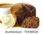 Sticky date pudding topped with caramel sauce and fresh cream.  Delicious! - stock photo