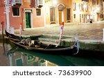 Venetian gondola at night near pier - stock photo