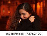 Girl in cold autumn night - stock photo