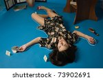 Poisoned brunette in a dressing gown lying on the floor - stock photo