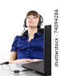 Support phone operator in headset at workplace relaxing - stock photo