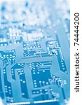 circuit board with shallow depth of field blue toned - stock photo