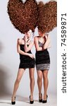 two girls with big curly heart-shaped hairstyle - stock photo
