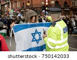 4th November 2017, London, United Kingdom:-Pro Isreali protester confronts a metropolitan police officer at a pro Palestine rally - stock photo
