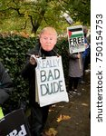 4th November 2017, London, United Kingdom:-Man dressed as Donald Trump at a pro palestine protest - stock photo