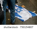 4th November 2017, London, United Kingdom:-The Isreali flag on the ground at a pro palestine rally - stock photo
