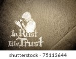 in rust we trust slogan sprayed on a decaying metal background - stock photo