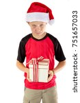 Sulky pre-teen boy with a christmas gift isolated on white background - stock photo