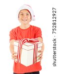 Young teenage boy holding a Christmas gift, isolated on white background - stock photo