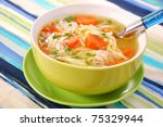 bowl of clear chicken soup with noodle and vegetables - stock photo