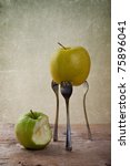 Still-Life with Apple stuck on three Forks - stock photo