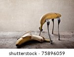 Still-Life with Banana stuck on four Forks - stock photo