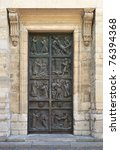 Ornate door to the medieval church in Paris. - stock photo